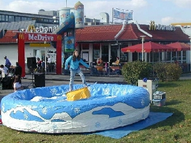 Snowboard in centre of inflatable bed