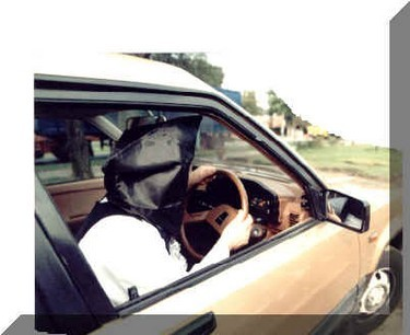 Behind the wheel to drive forward with no vision.