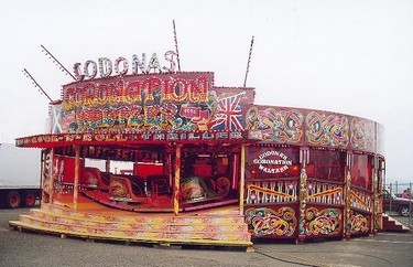 Waltzer cars spin round whilst travelling up and down