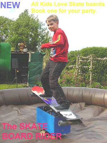 Skate board simulator on inflatable bouncy safety bed