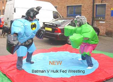 Wrestling in Batman and the Hulk costumes