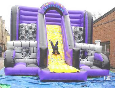 Climb the inflatable wall and then down the slide