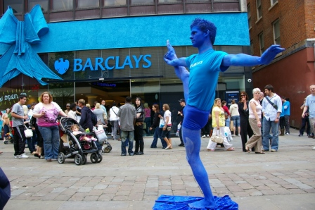 Brendan the Acrobat in action as Living Statue for Barclays Bank.