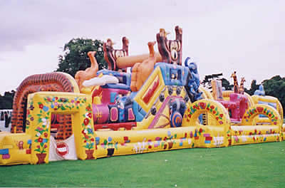 Inflatable obstacle course with bouncy castle, bish bash, cargo netting, slide