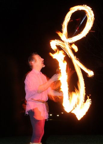 Juggler with fire clubs